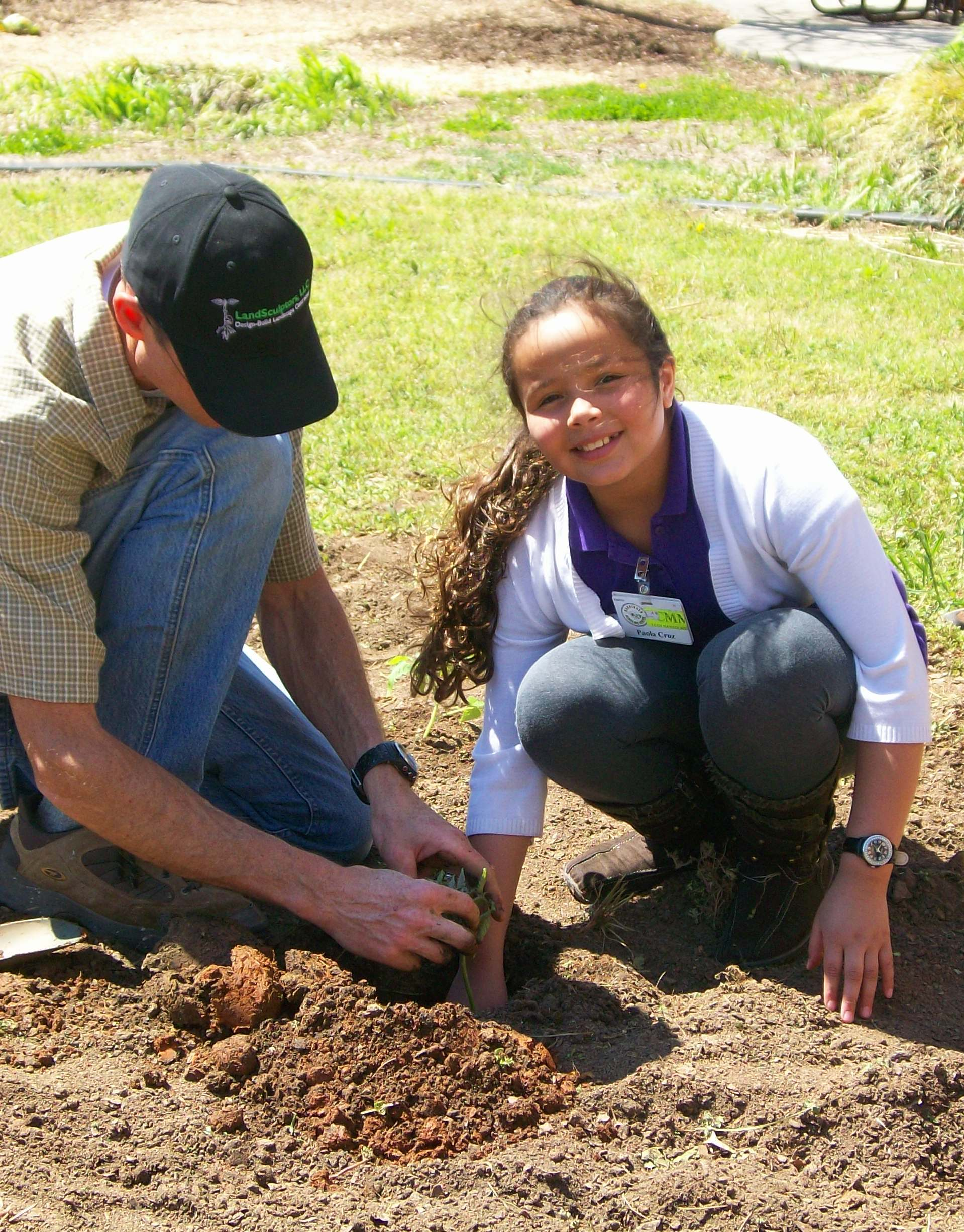 Student Planting Vegetables - Field to Fork